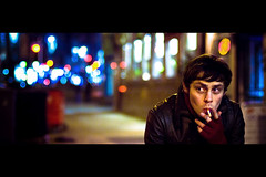 Kev (TGKW) Tags: city boy portrait people urban man leather night lights kevin cross bokeh glasgow cigarette smoke smoking jacket gloves charing nightlife kev filmformat