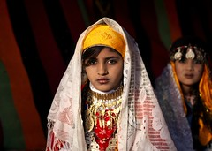 Veiled tuareg girls with jewels in Ghadames, Libya (Eric Lafforgue) Tags: africa girls portrait woman girl face female gold veiled veil northafrica or femme muslim jewelry bijoux tent arabic hasselblad explore jewels libya fille voile jewel visage headdress tente headwear headgear ghadames libia libye libyen veiledwoman coiffe ghadafi h3d  parure lbia 13355 tribalgirl lafforgue italiancolony jamahiriya libi fivestarsgallery libiya  ribia liviya khadafi ghadamis libija  tribalgirls femmevoilee      lbija  lby  libja lbya liiba livi