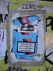 Religion Can Seriously Harm You and Others Around You (bixentro) Tags: streetart art warning graffiti artwork grafitti religion embassy vandalism packet graff cigarettes crushed