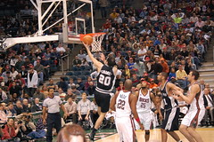 Manu Ginobili of the San Antonio Spurs lays it in (killbucky) Tags: basketball sanantonio nikon milwaukee olympics nba mowilliams milwaukeebucks bradleycenter sanantoniospurs manuginobili andrewbogut timduncan basquetbol d40 michaelredd basquetbolista