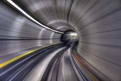 Space and time warp (PeterThoeny) Tags: kloten switzerland airport zurichairport zürich tunnel train traintunnel tube timetravel motion motionblur blur turn curve indoor 1xp raw nex6 photomatix sel50f18 hdr qualityhdr qualityhdrphotography fav500