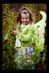 Woodland Fairy (DyeDye) Tags: playing green girl beautiful fun costume kid wings backyard nikon child availablelight daughter nikond100 dressup naturallight fairy fantasy tink stunning d100 2007 mydaughter 5yearsold fairywings playingdressup woodlandfairy kameryn november2007 fairysighting