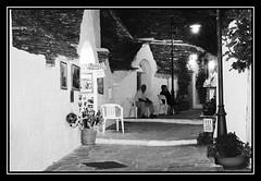 Alberobello, la sera (bettola) Tags: street summer blackandwhite bw italy night evening italia estate trulli puglia notte biancoenero sud sera stradina alberobello salita southitaly lastricato pisasocialevent