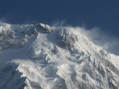 Snow flies off the top of Annapurna South