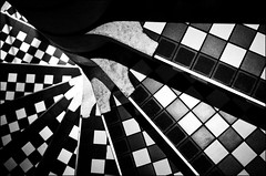 Spiral Staircase (chirgy) Tags: white black london spiral fuji steps scan lookdown tiles holborn neopan ammonite analogue pizzaexpress checks 400cn interestingness265 i500 onlyyourbestshots pentaxespio120mi