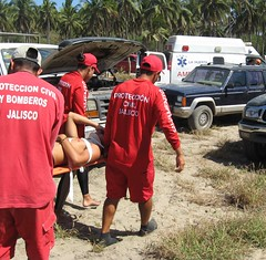 Hurt surfer hauled to ambulance