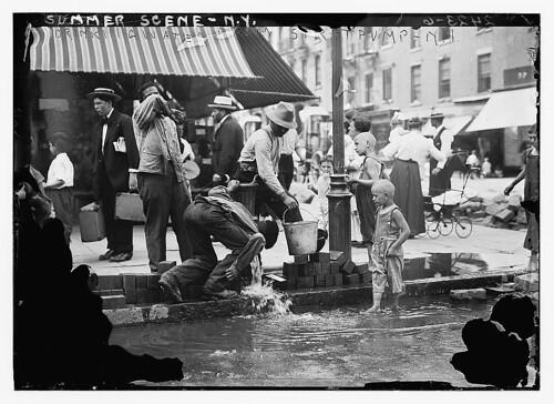 Summer scene, N.Y. - drinking water from street pump (LOC)