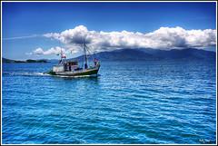 Blue (Kaj Bjurman) Tags: blue sea brazil water brasil clouds eos boat fishing bravo angradosreis kaj cs3 photomatix 40d anawesomeshot bjurman