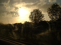 train to dorkink (nuage subtil) Tags: window train ligth reflectingsun