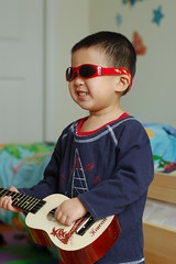 Posing with ukelele and new sunglasses