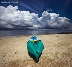 Kayak Points the Way (Ragstatic) Tags: travel blue sky holiday green tourism beach water coral clouds indonesia relax island boat google search sand nikon singapore rooms kayak earth rags room explore chalet reef whitesand stitched stay bintan d80 explore52 beachc nikoi rags1969 vertorama explorewinnersoftheworld ragsphotography