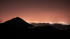 Lights in the night and old volcano (Robyn Hooz (away)) Tags: light italy canon volcano sigma os hills pollution luce padova luminoso inquinamento colli coth 18125 hsm euganei 1000d