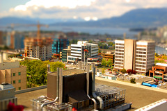 downtown up (russellk) Tags: street city light summer canada color colors vancouver clouds d50 toy toys miniature nikon cityscape afternoon bright britishcolumbia candid toytown tiltandshift