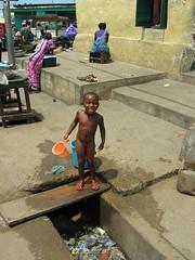 Bathing and Sewer (Peter Schnurman) Tags: girl child ghana bathing sewer capecoast elmina