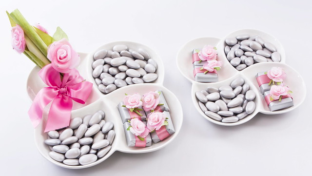 Lovely porcelain clover plates with decorated chocolates and silver dragees