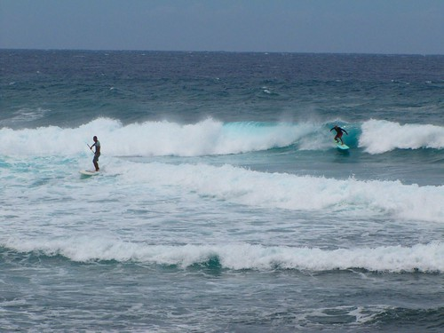 a duo of surfers