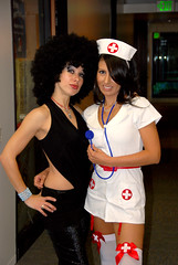 Monica & Farah (grokjohn ( john ) .popping in and out.) Tags: costumes party sexy halloween girl nikon indie latex paparazzi nurse nikkor partygirls d80 indie1031 nursecostume entravision grokjohn discochick