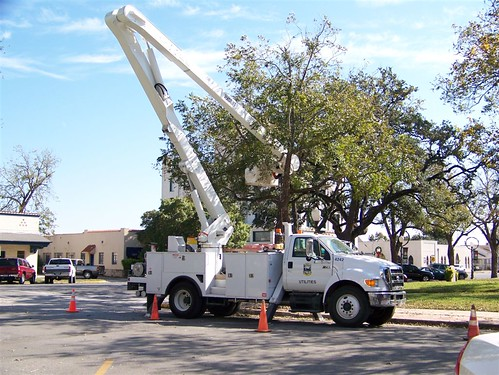 Christmas lights going up on the square in Seguin