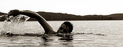 Swimming at dusk (delly17) Tags: lake ontario water swimming freestyle parks wave algonquin splash bronzed lakeoftworivers provincialparks