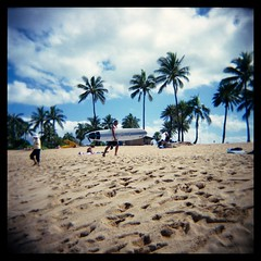 Beach + Surfer (Ralph Krawczyk Jr) Tags: 6x6 beach mediumformat hawaii sand oahu surfer toycamera lofi bluesky palmtrees squareformat holga120n allrightsreserved rckrawczykjr ralphkrawczykjr haeliwa
