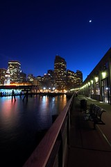 Along the Pier (mutekevin) Tags: sf sanfrancisco moon water night nikon embarcadero ferrybuilding 1224mmf4g 1224mm d40