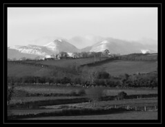 Snow topped Mountains (snoroma) Tags: winter blackandwhite mountain snow landscape northernireland mournemountains mournes codown mountainsofmourne slievebearnagh slievemeelmore annacloy