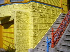 Yellow and blue and red. (A National Acrobat) Tags: blue red yellow steps garagedoor sfwalkr