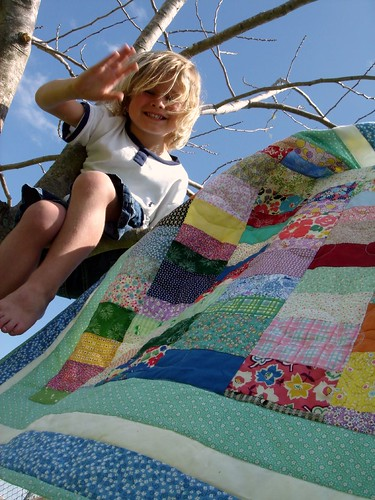 lap quilt with K. in a tree