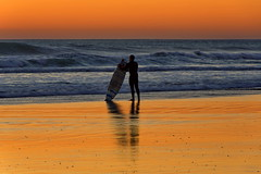 Last to Leave (suzanne~) Tags: surf surfer evening sunset ocean sea wave beach coast sand shore spain andalusia conildelafrontera