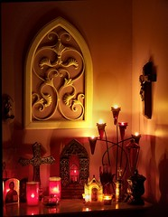 Altar In Reds (Tina @ King's Treasure Photo) Tags: light shadow red orange yellow worship meditate candle peace christ cross god pray jesus icon lord christian altar holy devotion crucifix spiritual contemplate incense votive