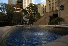 Jump (australianphotographer) Tags: city portrait urban man motion male fountain pool horizontal buildings jump movement action air extreme australia skills brisbane queensland freerunning extremesports airtime leap adrenaline thrills stunt parkour daring stopaction fullbody anzacsquare traceur strobist
