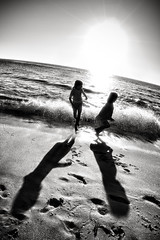 (thejbird) Tags: california shadow bw beach kids waves perspective ivy maren runaway lajollacove sigma15mmf28 weeklyperspectivearchival