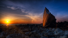 Sunset on an old wreck (Amundn) Tags: ocean sunset sun clouds geotagged boat stavanger nikon rocks colorful ship rusty lensflare wreck hdr jren d300 7xp