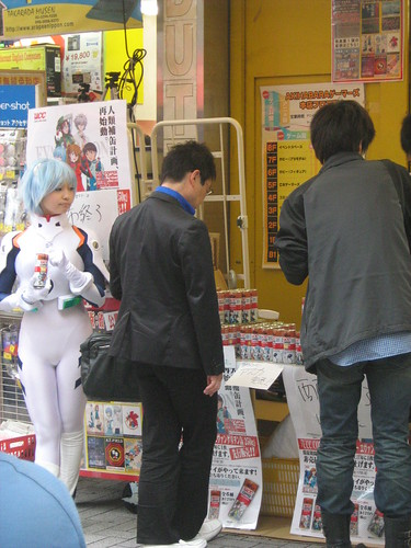 A customer buying coffee from Rei Ayanami cosplayer