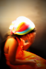 shy colors (hathu-) Tags: light red people orange colour green colors girl smile fashion photoshop canon happy person rainbow blurry focus asia warm soft flickr hand little young happiness shy malaysia saturation overexposed littlegirl shygirl canoneos450d hidingfromcamera hathu