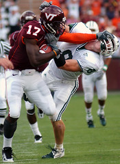Josh Morgan of Virginia Tech stiffarms Ohio defender (arnaudin) Tags: ohio college sports virginia football arm tech josh american morgan receiver defense stiff americanfootball virginiatech collegefootball offense stiffarm joshmorgan