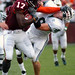 Josh Morgan of Virginia Tech stiffarms Ohio defender
