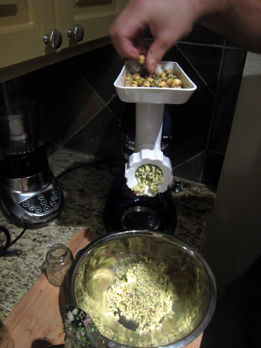 Chickpeas going through the grinder
