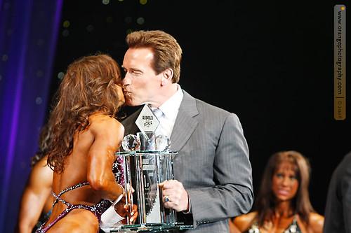 Arnold Schwarzenegger Puckers Up To Kim Klein