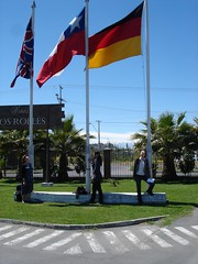 three flags (UK, Chile, Germany) with team members