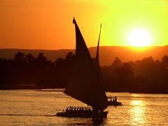 FELUCCA RIDE IN LUXOR, EGYPT (Butch Osborne) Tags: travel sunset orange sun color sol beautiful yellow del river boat sailing sonnenuntergang egypt nile salida traveling luxor puesta magnificent gct zonsopgang dazzling mustsee felucca  solde   leverdusoleil supershot grandcircletravel  excellentphotgraphersaward simplysuperb bucketlist travelpilgrims  peachofashot 5peaches