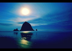 Cannon Beach @6AM in February (caterpillars) Tags: ocean longexposure blue sky moon reflection beach beautiful rock clouds oregon sunrise sand horizon wideangle pacificocean click canondigitalrebel cannonbeach haystackrock sigma1020mm cannonbeachoregon canon400d canonxti ekamil randlseattle2008 maxmum