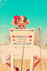 Pout (Odelay79) Tags: blue red sky white flower green field grass yellow vintage d50 golden weeds chair nikon child antique wheat daughter straw hidden hide madison pout tall hay pigtails redshoes pettiskirt pouty straddle grasp torquoise whiteskirt