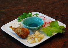 Day 51: seder plate - tofu stand-in for egg; parsley; radish (instead of horseradish); lettuce; coconut lemon almond haroset; vegan lamb shank