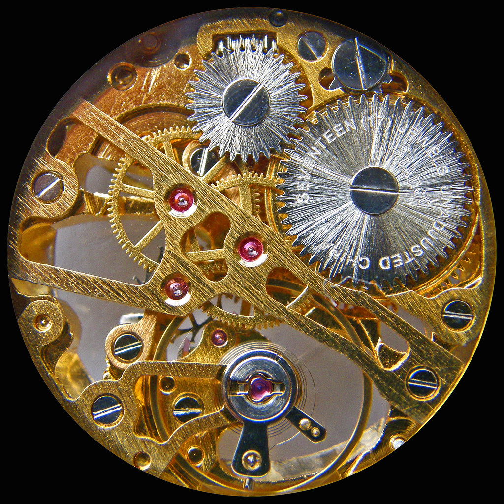 New old skeleton watchworks, seen through its crystal back