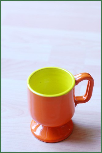 vintage yellow and orange mug