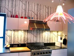 Wallpaper as a backsplash is generally considered to be old-fashioned, but with the right choice it can look fantastic
