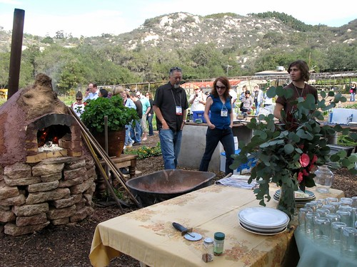 The tour group filing into the outdoor kitchen