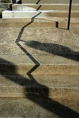 Step Shadows (alankin) Tags: light 15fav texture philadelphia geometric vertical nikon cityscape shadows pennsylvania cement d70s steps angles 1870mmf3545g philly lookingdown nikkor mountairy railings mtairy almostmonochromatic xmap utatathursdaywalk 30views niknala utatathursdaywalk35 14dec2006 1200001cmu