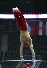Fabian Leimlehner - high bar training 6 (roflmeter) Tags: red shirtless male college sports muscle ripped young hunk gymnast gymnastics fabian gym abs sixpack defined parallelbar pommelhorse highbar artisticgymnastics stillrings fabianleimlehner leimlehner